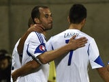 Israel's forward Omer Damari (L) celebrates with teammates after scoring a goal during the Euro 2016 group D qualifying football match between Andorra on October 13, 2014