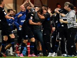 Paderborn´s players celebrate during the German First division Bundesliga football match SC Paderborn 07 vs Eintracht Frankfurt on October 19, 2014