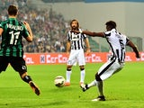Juventus French midfielder Paul Pogba kicks and scores during the Serie A football match between Sassuolo and Juventus at the Mapei Stadium in Reggio Emilia on October 18 , 2014
