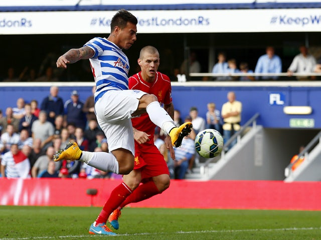 Eduardo Vargas of QPR scores his team's first goal during the Barclays Premier League match between Queens Park Rangers and Liverpool at Loftus Road on October 19, 2014