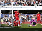 Liverpool's Slovakian defender Martin Skrtel clears the ball after a goal-mouth scramble during the Premier League match against Queens Park Rangers at Loftus Road on October 19, 2014