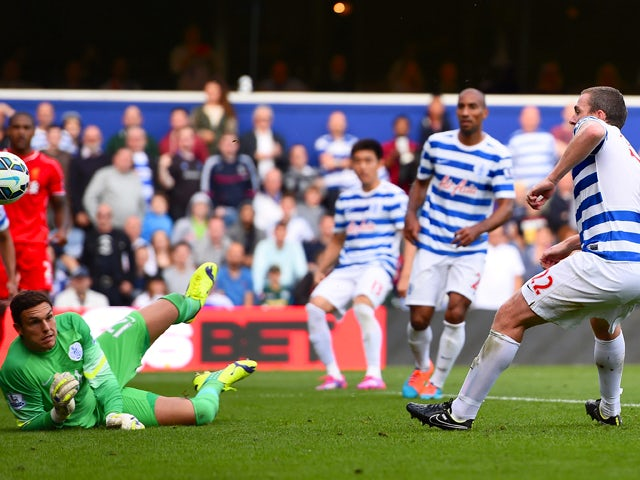 Richard Dunne of QPR scores an own goal past Alex McCarthy during the Barclays Premier League match between Queens Park Rangers and Liverpool at Loftus Road on October 19, 2014