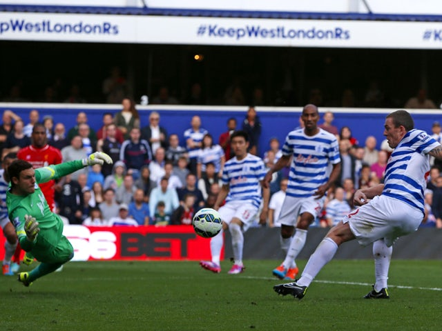 Queens Park Rangers' Irish defender Richard Dunne diverts the ball into his own net past Queens Park Rangers' English goalkeeper Alex McCarthy to give Liverpool the lead during the English Premier League football match between Queens Park Rangers and Live