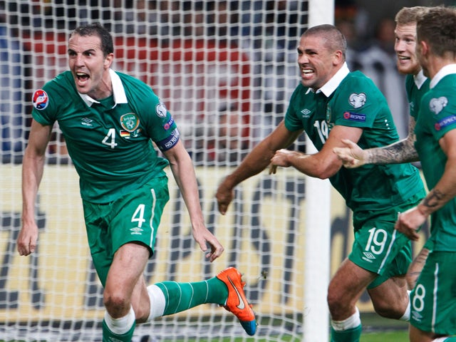 Republic of Ireland's defender John O'Shea celebrates scoring the last minute equalizer with his team-mates during the UEFA Euro 2016 Group D qualifying football match Germany vs Republic of Ireland in Gelsenkirchen, western Germany on October 14, 2014