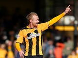 Robbie Simpson of Cambridge celebrates after scoring the teams fifth goal during the Sky Bet League Two match between Cambridge United and Oxford United at The Abbey Stadium on October 11, 2014