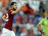 AS Roma forward Mattia Destro celebrates after scoring during the Italian Serie A football match Roma vs Chievo on October 18, 2014
