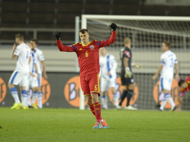 Romania's Vlad Chiriches celebrates the 0-1 goal by team mate Bogdan Stancu during the UEFA Euro 2016 Group F qualifying football match Finland vs Romania in Helsinki, Finland on October 14, 2014