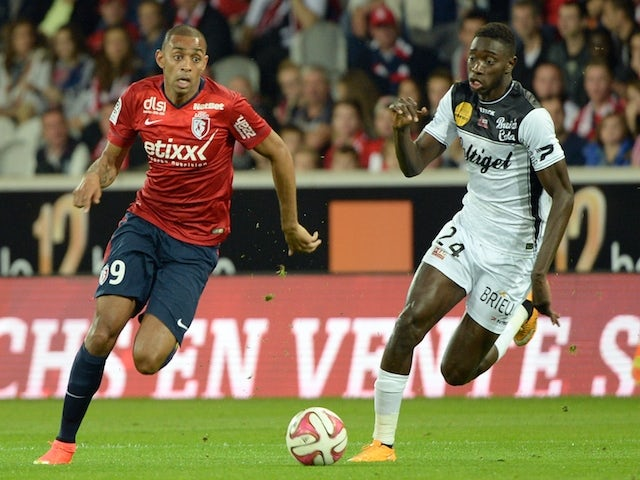 Lille's Brazilian forward Ronny Rodelin (L) vies with Guingamp's midfielder Sambou Yatabare during the French L1 football match Lille vs Guingamp on October 18, 2014