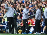 Russell Slade the new manager of Cardiff City celebrates his sides first goal during the Sky Bet Championship match between Cardiff City and Nottingham Forest at Cardiff City Stadium on October 18, 2014