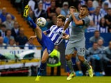 Sam Hutchinson of Sheffield Wednesday in action with Mehdi Abeid (R) of Newcastle during the Pre Season Friendly between Sheffield Wednesday and Newcastle United at Hillsborough on July 30, 2014