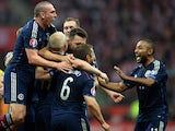 Scotland's players react after Steven Naismith scored a goal against Poland during the UEFA Euro 2016 Group D qualifying football match Poland vs Scotland in Warsaw, Poland on October 14, 2014