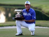 Scott Hend of Australia celebrates with the trophy after winning the final round of the 2014 Hong Kong open at The Hong Kong Golf Club on October 19, 2014