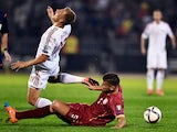 Serbia's Matija Nastasic vies with Albania's Bekim Balaj during the EURO 2016 group I football match between Serbia and Albania in Belgrade on October 14, 2014