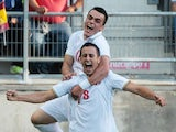 Aleksandar Pesic of Serbia celebrates with Filip Kostic after scoring during the 2015 UEFA European Under-21 Championship play-off football match between Spain and Serbia at the Carranza Stadium on October 14, 2014