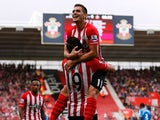 Dusan Tadic and Graziano Pelle of Southampton celebrate during the Barclays Premier League match between Southampton and Sunderland at St Mary's Stadium on October 18, 2014