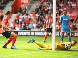 Jack Cork of Southampton beats Vito Mannone of Sunderland to score their third goal during the Barclays Premier League match between Southampton and Sunderland at St Mary's Stadium on October 18, 2014