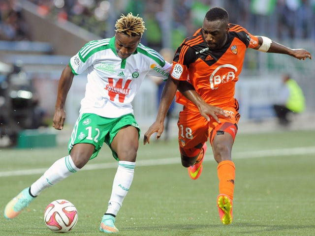 Lorient's French Togolese forward Gilles Sunu challenges Saint-Etienne's French forward Allan Saint-Maximin during the French L1 football match between Lorient and Saint-Etienne at the Moustoir stadium in Lorient, western France, on October 18, 2014