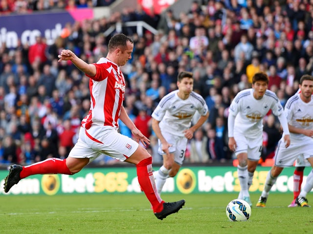 Stoke player Charlie Adam scores from the penalty spot during the Barclays Premier League match between Stoke City and Swansea City at Britannia Stadium on October 19, 2014