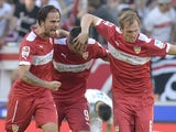 Stuttgart's Austrian forward Martin Harnik, Bosnian-Herzegovinian forward Vedad Ibisevic and defender Georg Niedermeier celebrate after Harnik scored the equalizing goal during the German First division Bundesliga football match VfB Stuttgart vs Bayer 04