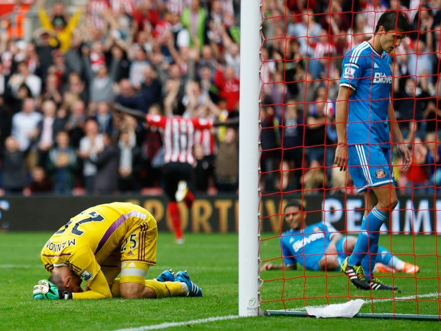 Despair for goalkeeper Vito Mannone and the Sunderland defence as Sadio Mane of Southampton scores the eight goal during the Barclays Premier League match between Southampton and Sunderland at St Mary's Stadium on October 18, 2014