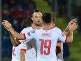Switzerland's forward Haris Seferovic celebrates with teammates after scoring on October 14, 2014
