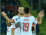 Switzerland's forward Haris Seferovic celebrates with teammates after scoring on October 14, 2014