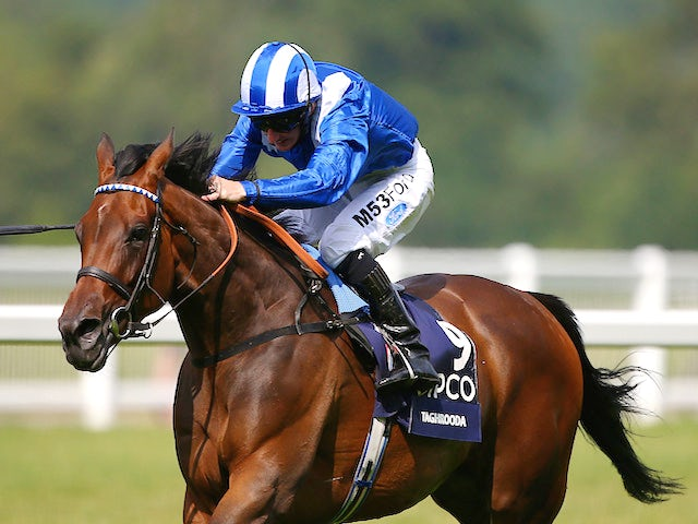Paul Hanagan riding Taghrooda wins The King George VI and Queen Elizabeth Stakes at Ascot racecourse on July 26, 2014