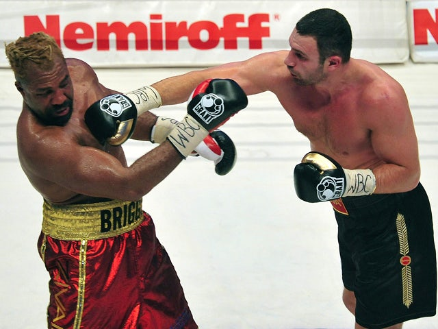 Ukrainian boxer Vitali Klitschko fights with US boxer Shannon Briggs during the WBC heavyweight boxing title in Hamburg on October 16, 2010