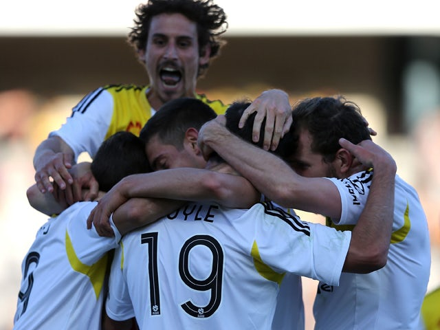 Wellington Phoenix teammares celebrate a goal during the round two A-League match between the Central Coast Mariners and the Wellington Phoenix at Central Coast Stadium on October 18, 2014