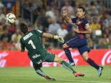 Barcelona's midfielder Xavi Hernandez scores a goal during the Spanish league football match FC Barcelona vs Eibar at the Camp Nou stadium in Barcelona on October 18, 2014