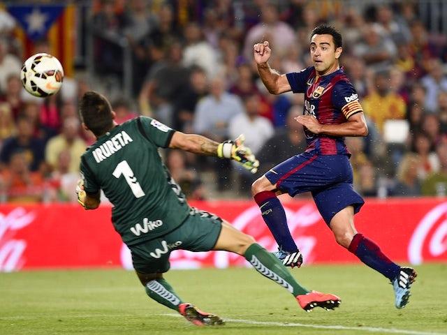 Barcelona's midfielder Xavi Hernandez scores a goal during the Spanish league football match FC Barcelona vs Eibar at the Camp Nou stadium in Barcelona on October 18, 2014