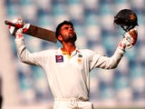 Ahmed Shehzad of Pakistan celebrates as he reaches his century during day four of the First Test between Pakistan and Australia at Dubai International Stadium at Dubai International Stadium on October 25, 2014