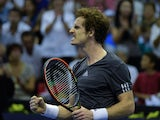 British player Andy Murray celebrates after winning the semi-final tennis match against Spanish player David Ferrer at the ATP Valencia tennis Open at the City of Arts and Science complex in Valencia on October 25, 2014