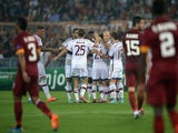 Bayern Munich's forward from Netherlands Arjen Robben (C) celebrates with teammates after scoring during the Champions League group stage football match AS Roma vs Bayern Munich on October 21, 2014