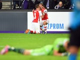 Arsenal's English defender Kieran Gibbs celebrates with Arsenal's Spanish defender Nacho Monreal after scoring during a UEFA Champions League group stage football match Anderlecht vs Arsenal at the Constant Vanden Stock stadium in Anderlecht on October 22