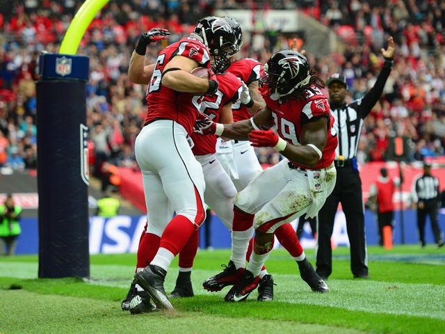 Bear Pascoe #86 of the Atlanta Falcons celebrates scoring a touchdown in the first quarter with Steven Jackson #39 of the Atlanta Falcons during the NFL match between Detroit Lions and Atlanta Falcons at Wembley Stadium on October 26, 2014