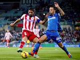 Raul Garcia of Atletico Madrid competes for the ball with Alexis Ruano of Getafe CF during the La Liga match between Getafe CF and Club Atletico de Madrid at Coliseum Alfonso Perez on October 26, 2014