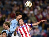 Malmo's defender Erik Johansson vies with Atletico Madrid's midfielder Saul Niguez during the UEFA Champions League football match Club Atletico de Madrid vs Malmo FF at the Vicente Calderon stadium in Madrid on October 22, 2014