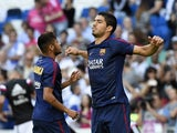 Barcelona's Uruguayan forward Luis Suarez warms up before the Spanish league 'Clasico' football match Real Madrid CF vs FC Barcelona at the Santiago Bernabeu stadium in Madrid on October 25, 2014