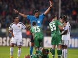 Referee Deniz Aytekin shows a red card to Basel's midfielder Geoffroy Serey Die during the UEFA Champions League Group B match between Ludogorets Razgrad and FC Basel 1893 at the Vassil Levski stadium in Sofia on October 22, 2014