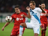 Leverkusen's Italian defender Giulio Donati and Zenit's Italian defender Domenico Criscito vie for the ball during the first leg UEFA Champions League Group C football match Bayer 04 Leverkusen vs FC Zenit St Petersburg, in Leverkusen, western Germany on