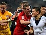 Leverkusen´s players celbrate after the German First division Bundesliga football match Bayer 04 Leverkusen v FC Schalke 04 on October 25, 2014