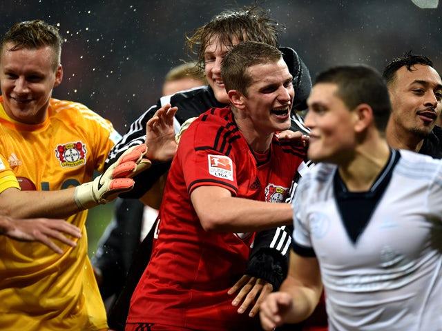 Leverkusen�s players celbrate after the German First division Bundesliga football match Bayer 04 Leverkusen v FC Schalke 04 on October 25, 2014