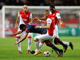 Benfica's Argentine forward Eduardo Salvio vies with Monaco's French defender Layvin Kurzawa during the UEFA Champions League Group C football match Monaco (ASM) vs Benfica (SLB) at the Louis II Stadium in Monaco on October 22, 2014