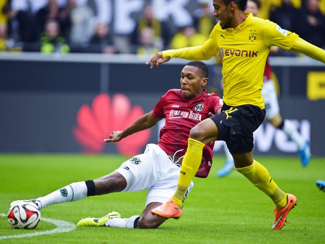 Dortmund's Pierre-Emerick Aubameyang vie for the ball with Hannover's Marcelo during the German First division Bundesliga football match Borussia Dortmund vs Hannover 96 on October 25, 2014