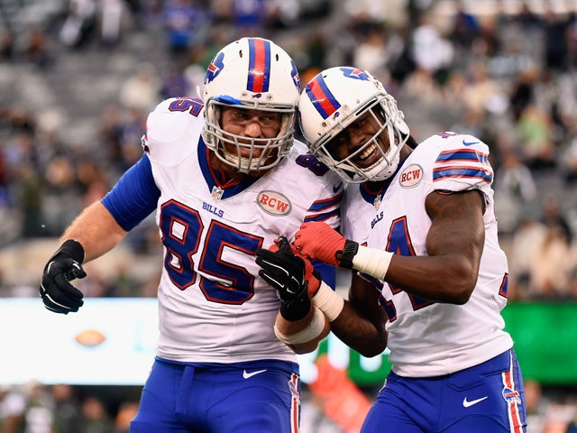 Sammy Watkins #14 of the Buffalo Bills celebrates his 61-yard touchdown with teammate Lee Smith #85 against the New York Jets in the fourth quarter at MetLife Stadium on October 26, 2014