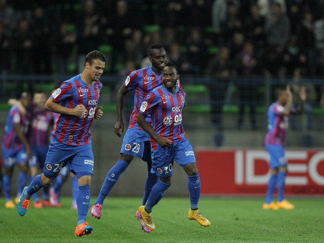 Caen's French forward Lenny Nangis celebrates with teammates after scoring a goal during the French L1 football match between Caen (SMC) and Lorient (FCL) at the Michel d'Ornano stadium in Caen, northwestern France on October 25, 2014