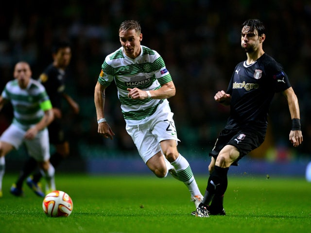Stephan Johansen of Celtic and Vincent Laban of FC Astra Giurgiu challenge during the UEFA Europa League group D match between Celtic FC and FC Astra Giurgiu at Celtic Park on October 23, 2014