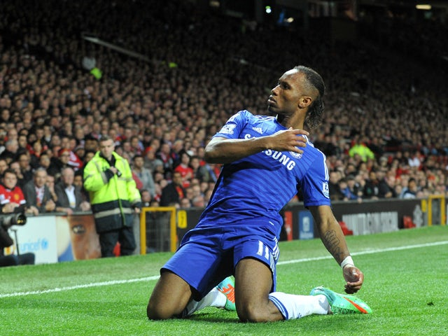 Chelsea's Ivorian striker Didier Drogba celebrates scoring the opening goal of the English Premier League football match between Manchester United and Chelsea at Old Trafford in Manchester, north west England, on October 26, 2014