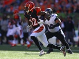 Mohamed Sanu #12 of the Cincinnati Bengals runs with the ball after catching a pass during the third quarter of the game against the Baltimore Ravens at Paul Brown Stadium on October 26, 2014